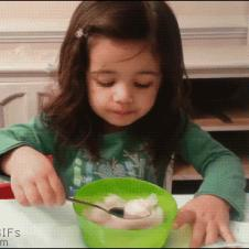 A girl has a hard time with brain freeze.