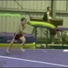 Boy-gymnastics-flips-head-plant
