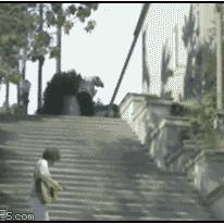 A guy falls down stairs in style