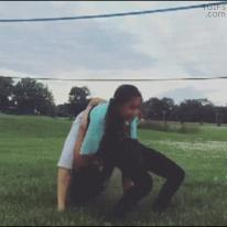 A girl trying gymnastics does a piledriver