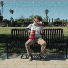 A guy uses Doritos to attempt to attract a female jogger.