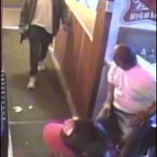A bouncer elbows a man entering with a gun and chases him off.