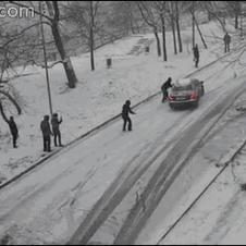 Man stops sliding car.
