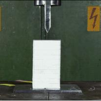 Splitting 10 decks of cards with a hydraulic press is satisfying.