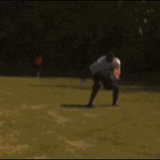 Football-player-jumps-through-car