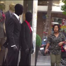 A man pretends to be a mannequin