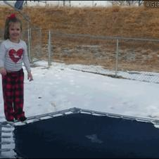Kid-jumps-on-frozen-ice-trampoline