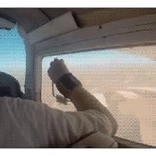 A man's cellphone gets sucked out of an open airplane window.