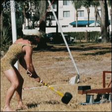 Strongman-hammer-stunt