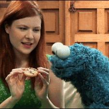 The Cookie Monster is teased with a cookie.