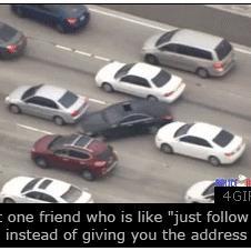 Car-drives-between-traffic-lanes