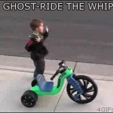 A kid ghost rides his ride.