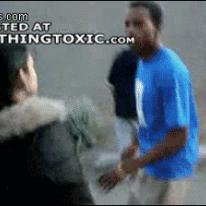 Girl punches guy.