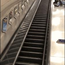 Drunk-guy-slides-down-escalator