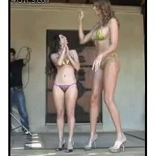 Very tall model meets short model.