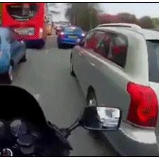 Polite-motorcyclist-fixes-mirror
